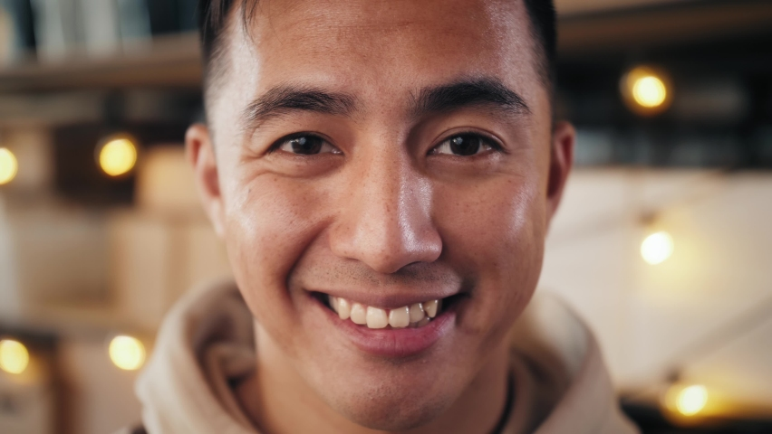 Japanese Asian man eyes close-up detail macro shot, portrait macro of asian man, happy young student Royalty-Free Stock Footage #1060690915