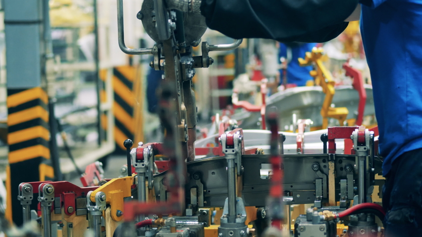 Car element is being spot-welded by a factory worker. Automotive industry concept.   Shutterstock HD Video #1060696939