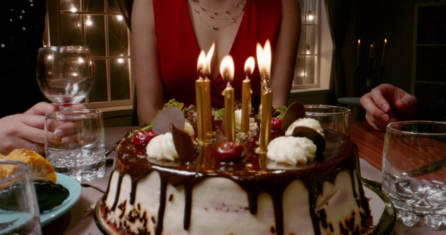 Group of multiethnic friends celebrating birthday, clapping and cheering. Beautiful caucasian girl is blowing out candles on birthday cake - happy people, holidays, friendship concept 4k footage | Shutterstock HD Video #1060702564