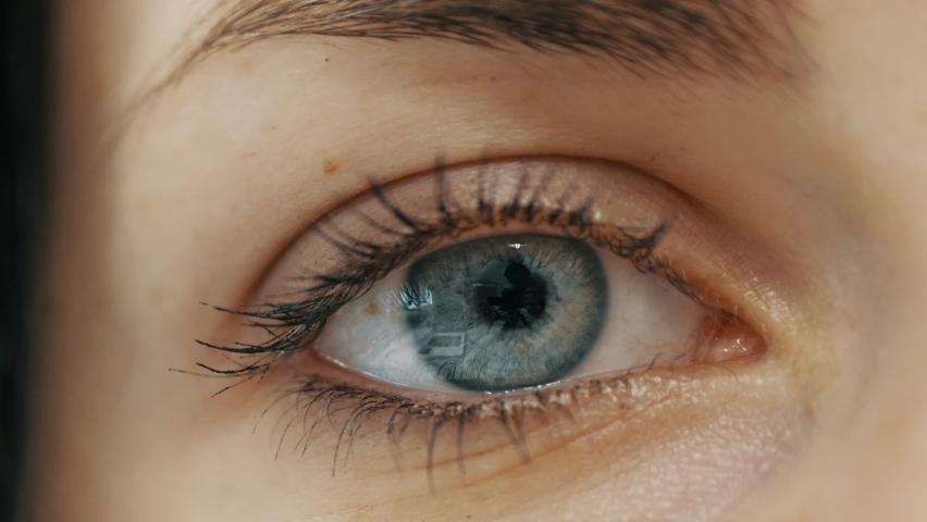 Close-up of female eye opening with beautiful blue iris. | Shutterstock HD Video #1060704691