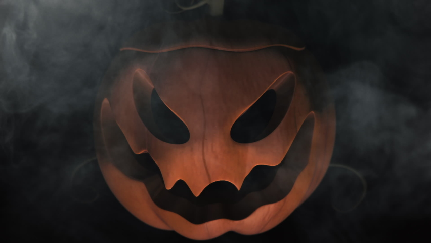 Animation of the appearance of a Halloween pumpkins from the darkness. Horror scene or Halloween decoration. | Shutterstock HD Video #1060710037