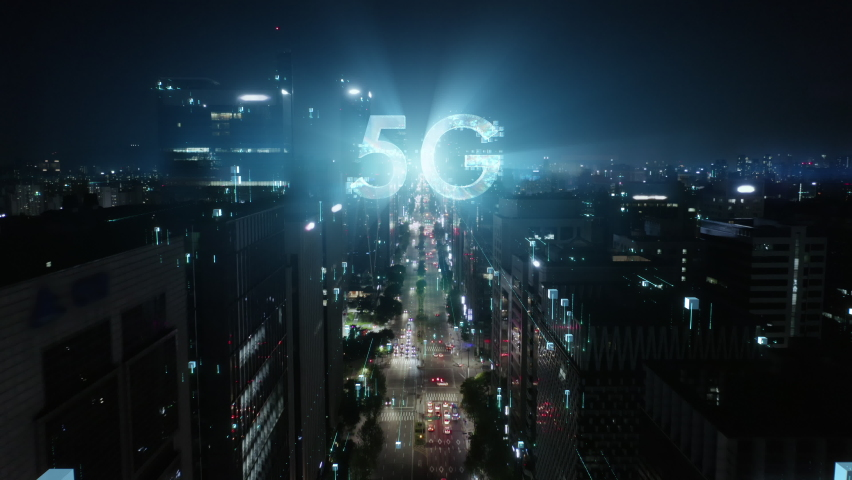 5G technology conсept in the city of the future. Beautiful aerial panorama of modern skyscrapers, streets and traffic all in glittering lights on the night.  Royalty-Free Stock Footage #1060713574
