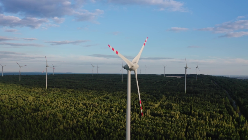 Aerial view of windmills farm for energy production . Wind power turbines generating clean renewable energy for sustainable development | Shutterstock HD Video #1060714762