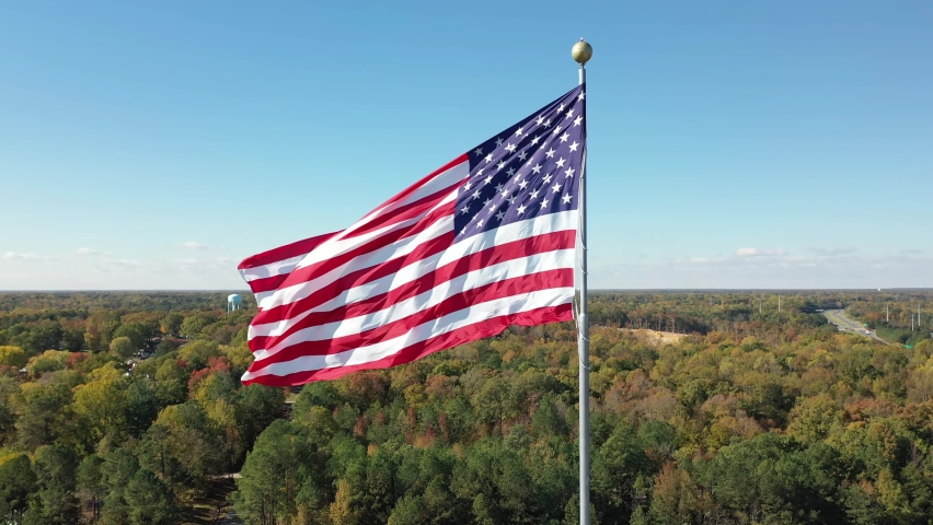 Large American Flag Waving Flies 4K Aerial Drone View Footage National American Celebration - Labor Day, Independence Day, Flag Day, Memorial, Veterans, Patriots, President Day | Shutterstock HD Video #1060728655