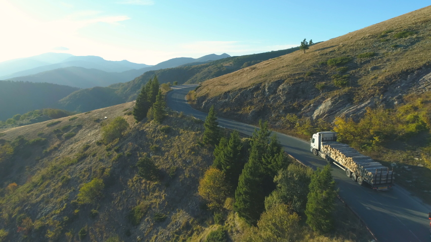 Aerial View Of A two timber truck Driving Along A Mountain pass in sunny day Royalty-Free Stock Footage #1060736668