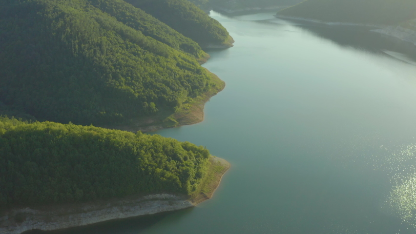 Aerial shot of Serbia. Drone video hydro power plant standing in the mountains where you can see forests, water, lake, dam, beautiful landscape. | Shutterstock HD Video #1060738648