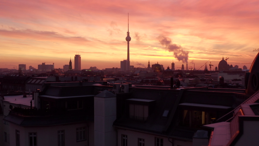Wide Establishing Aerial Sunset or Sunrise Shot of Berlin, Germany Skyline with Red Sky
