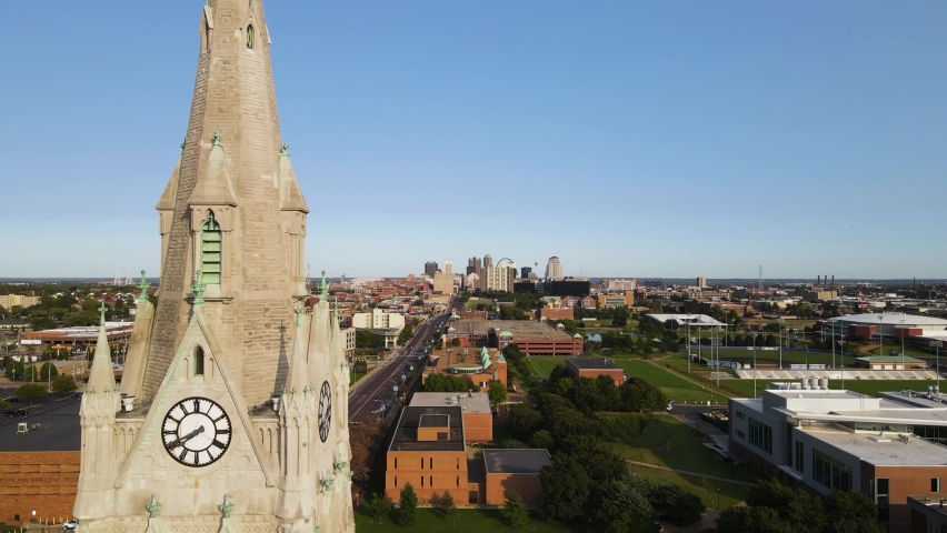 Clock Tower Reveal of American City of St. Louis - Copy Space for Text in Sky. Aerial Establishing Drone View