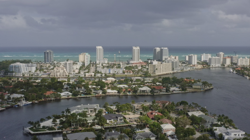 Fort Lauderdale Florida Aerial pan right shot of Seven Isles neighborhood and Central Beach on horizon - March 2020   Shutterstock HD Video #1060755304