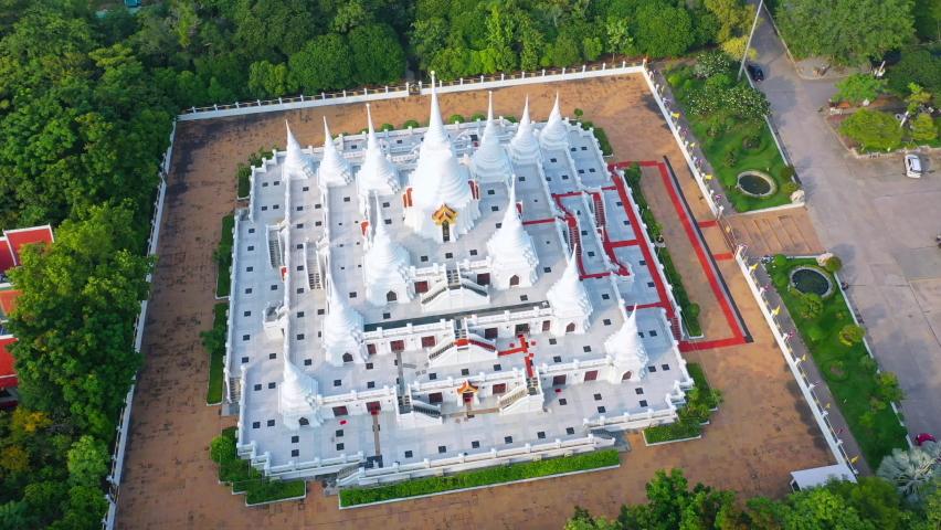 White Buddhist Pagoda with multiple spires at Wat Asokaram Temple in Samutprakan province, Thailand. | Shutterstock HD Video #1060756219