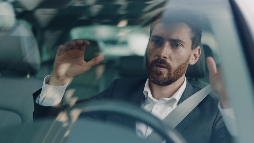 Unhappy young man driving sitting car in city at sunlight. Feel angry stress depression. Look serious automobile. Frustrated tired. Close up. Slow motion Royalty-Free Stock Footage #1060757650