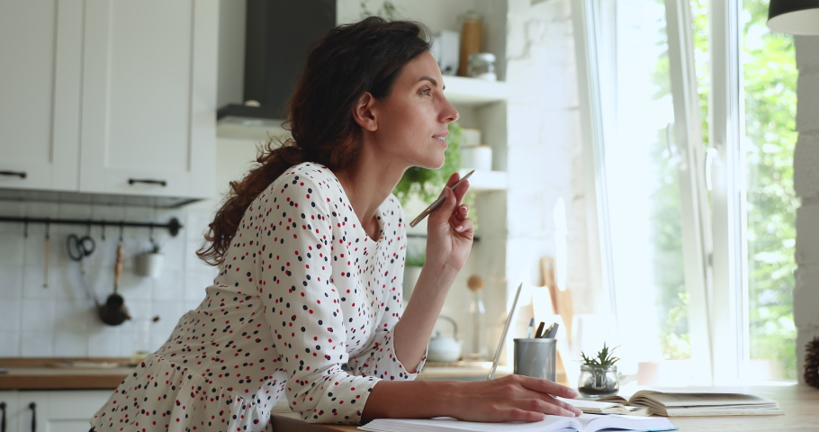In home kitchen 35s woman read textbooks writes notes, create essay, make research, receive second higher education, enjoy self-education, prepares for seminar professional occupation training concept Royalty-Free Stock Footage #1060761580