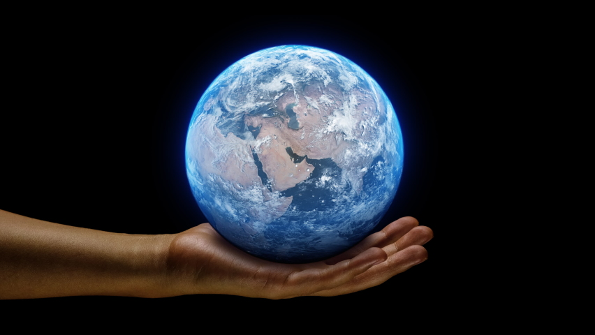 Hand holding a realistic earth planet. Ruling power concept using earth on hands. World globe spinning from asia to europe. Royalty-Free Stock Footage #1060764088