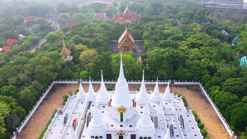 White Buddhist Pagoda with multiple spires at Wat Asokaram Temple in Samutprakan province, Thailand. | Shutterstock HD Video #1060767364
