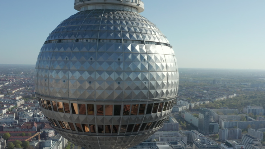 AERIAL: Super Close Up View Circle around the Alexanderplatz TV Tower in Berlin, Germany on hot summer day