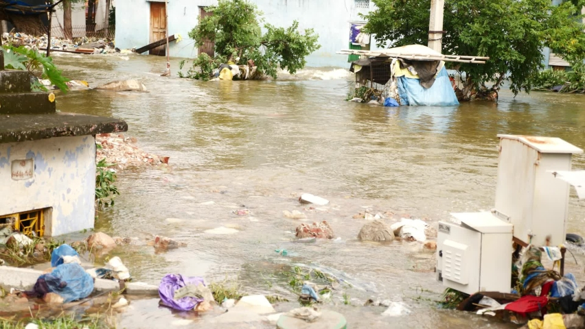 Shops and buildings are submerged in the flood water, floods during the monsoon season
