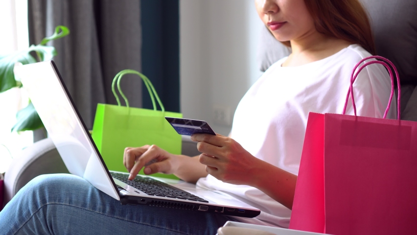 Young Asian women inputting card information while shopping online with computer at home. Shopping online, e-commerce concept. Closeup Royalty-Free Stock Footage #1060794841