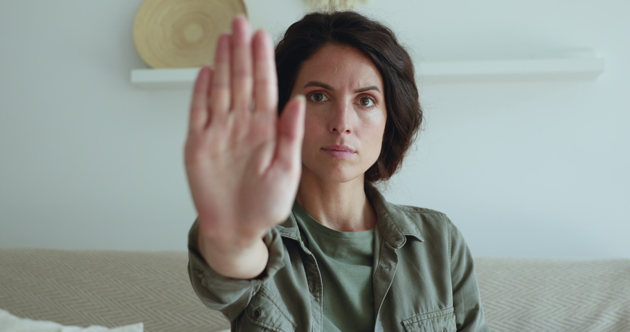 Serious girl stretch out her palm to camera says stop abortion, close up. Community participant anti domestic violence, racism racial discrimination. Struggle for women rights, social problems concept Royalty-Free Stock Footage #1060798951