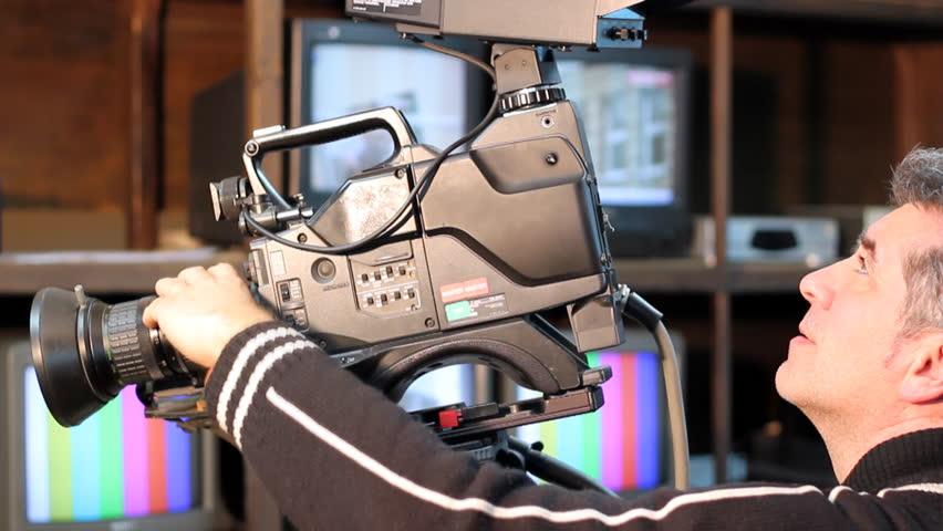 Camera operator using a television camera.  (HD 1080p. Canon EOS 550D)