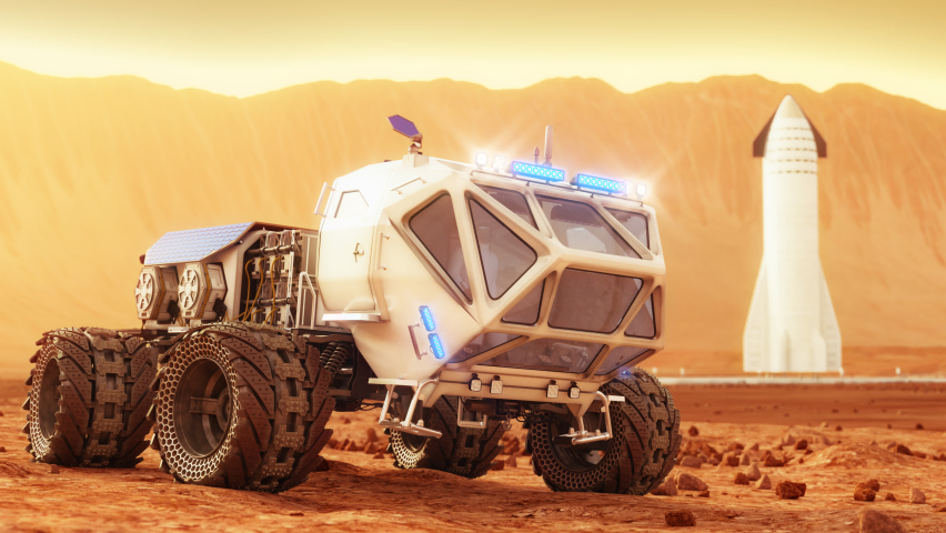 The cargo rover is moving on the surface of Mars. Starship in the background. 4K footage   Shutterstock HD Video #1060824928