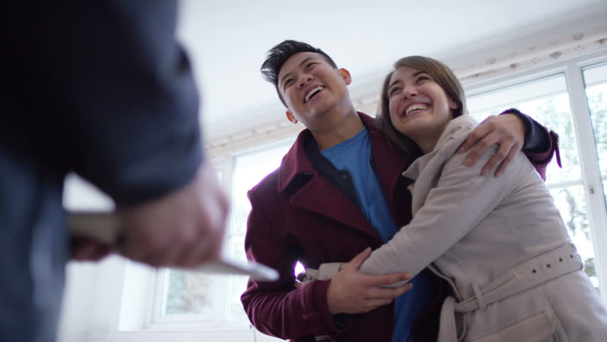 4K Young couple with real estate agent, looking at home to buy or rent #10608266