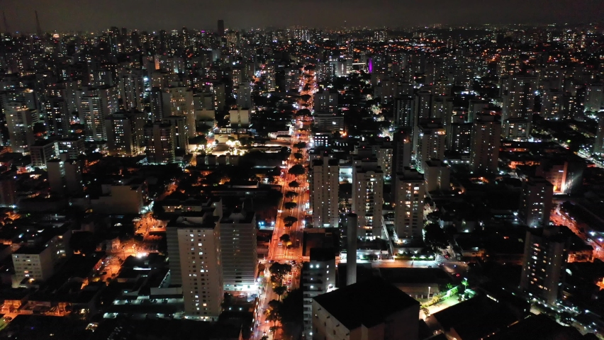 Aerial landscape of colorful city at night. Great night landscape. Famous Pompeia Avenue, Sao Paulo. Downtown city aerial view. Downtown city at night. Night life aerial view. Nightlife avenue view Royalty-Free Stock Footage #1060830703