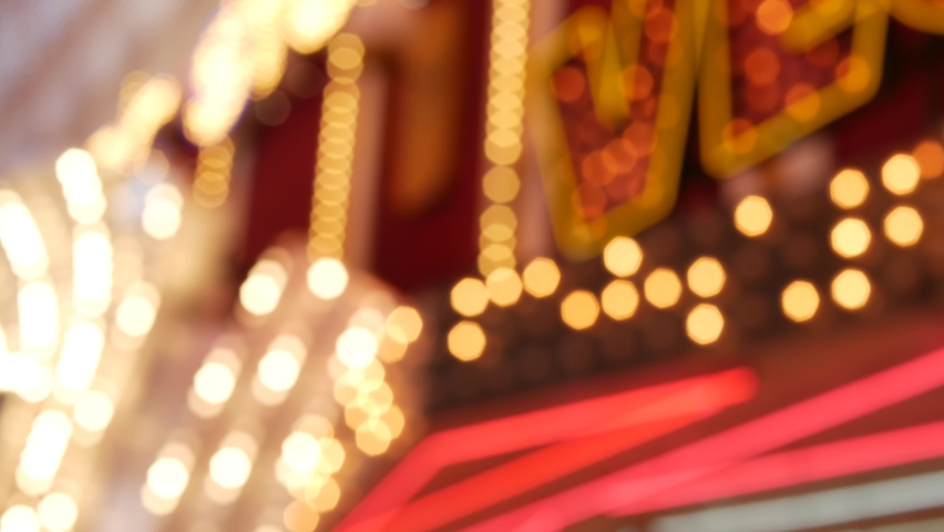 Defocused old fasioned electric lamps glowing at night. Abstract close up of blurred retro casino decoration shimmering, Las Vegas USA. Illuminated vintage style bulbs glittering on Freemont street. | Shutterstock HD Video #1060839799