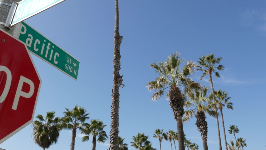 Pacific street road sign on crossroad, route 101 tourist destination, California, USA. Lettering on intersection signpost, symbol of summertime travel and vacations.Signboard in city near Los Angeles. | Shutterstock HD Video #1060844479