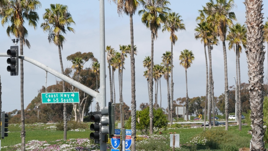 Pacific Coast Highway, historic route 101 road sign, tourist destination in California USA. Lettering on intersection signpost. Symbol of summertime travel along the ocean. All-American scenic hwy. | Shutterstock HD Video #1060844482