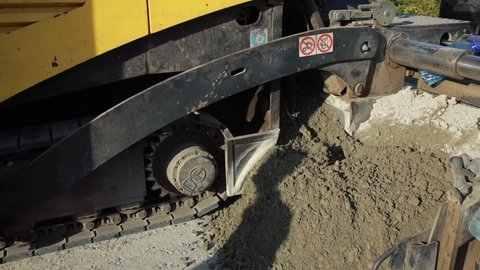 Road equipment. Road construction. Construction Materials. Styling. Crushed stone-sand mixture. Shot off hand. Close-up