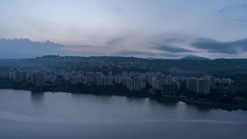 Beautiful 4k Sunrise Time Lapse, Cityscape view and and Reflection in the Lake water, Maharashtra, India