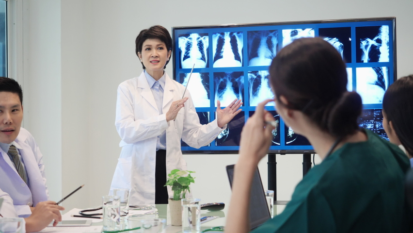 Leader medical team presenting symptoms of patient with x-ray at hospital. Doctor brainstorming examination of the symptoms patient at meeting room.
