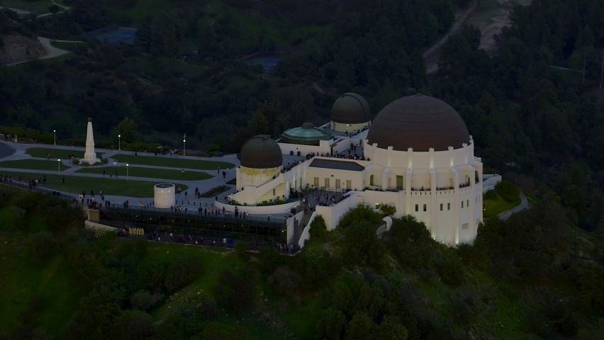 Amazing view of the Griffith Observatory in Mount Hollywood. Los Angeles, California. Beautiful sky during sunset.Crowded entrance lawnand observation deck. Shot on Red Weapon 8K. | Shutterstock HD Video #1060867705