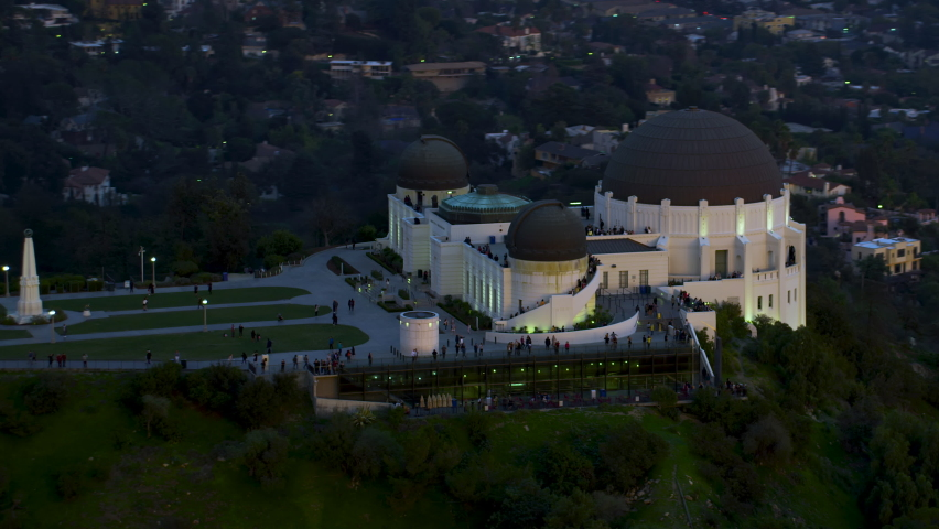 Amazing view of the Griffith Observatory in Mount Hollywood. Crowded entrance lawnand observation deck. Los Angeles, California. Beautiful sky during sunset. Shot on Red Weapon 8K. | Shutterstock HD Video #1060867708