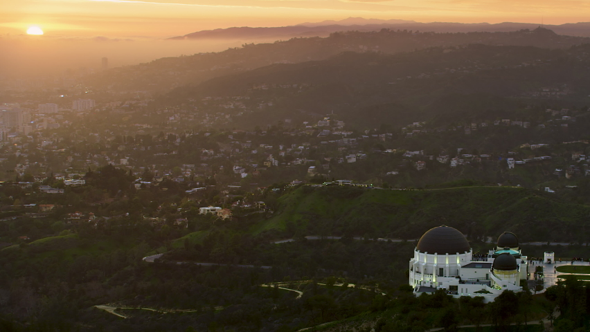 Beautiful view of the Griffith Observatory. Sunset over the hills. Skyline in the background. Los Angeles, California. Shot on Red Weapon 8K. | Shutterstock HD Video #1060867711