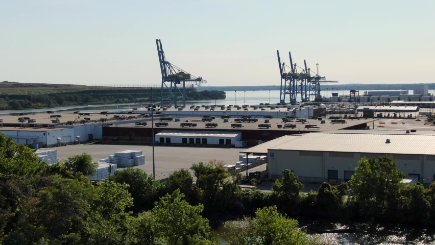 Establishing aerial shot of quiet port in United States, shut down due to coronavirus, COVID-19. Import export of goods halted during pandemic. Shipping at dock in USA. | Shutterstock HD Video #1060869550