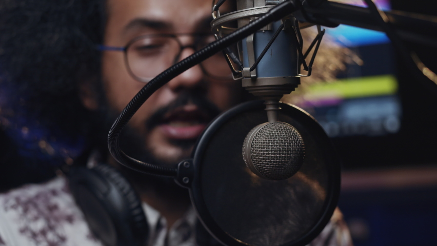 Podcast Recording. Inspirational men. Hispanic man recording voice over. An intelligent brunette male person records his voice. Royalty-Free Stock Footage #1060883347