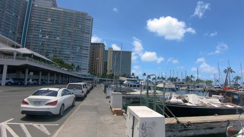 Hawaii / United States - 01 04 2020: View of a marina with anchored yachts near hotels on a sunny day