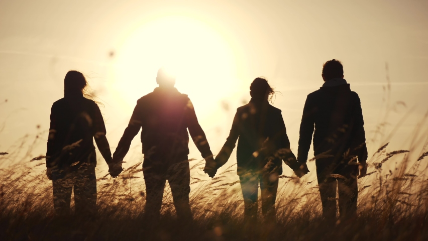 teamwork. team community hold hands together silhouette at sunset unity. group of people hands. teamwork workers carry out put your hands up . team in the company working partnership business Royalty-Free Stock Footage #1060907581