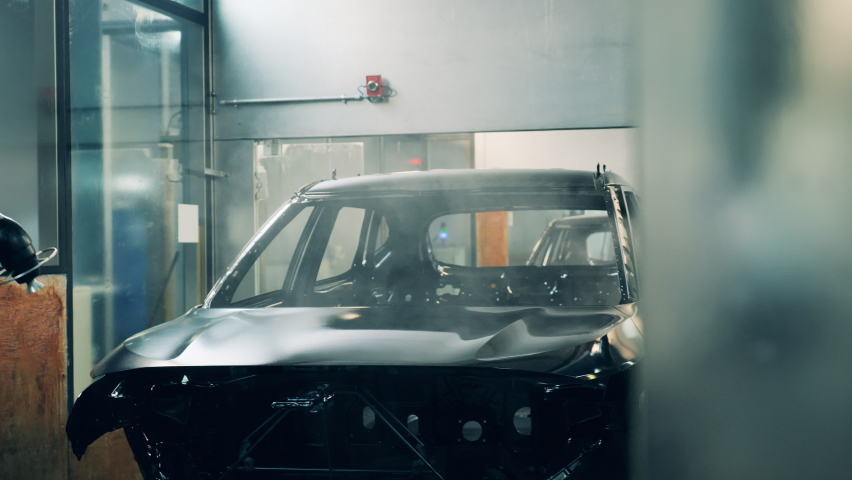 Robots painting a car. Car production line Royalty-Free Stock Footage #1060913179
