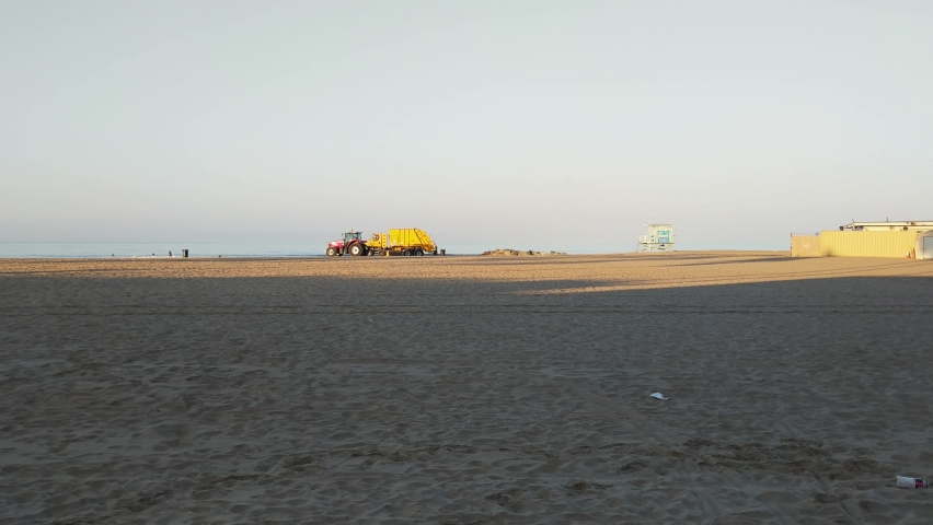 Morning beach cleaning tractor and garbage collection at Santa Monica pier | Shutterstock HD Video #1060916122