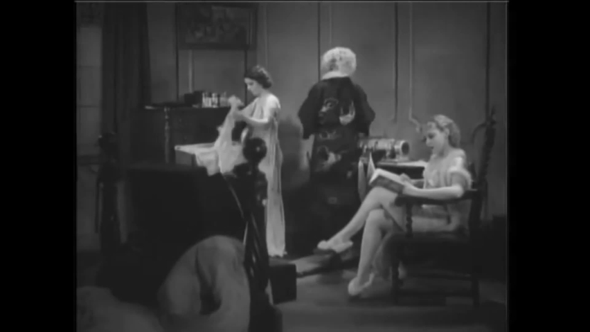 CIRCA 1934 - In this exploitation movie, women lounge around their hotel room in their underwear and one uses an exercise belt machine.