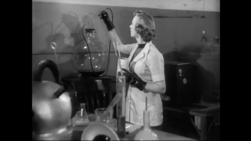 CIRCA 1953 - In this sci-fi film, a scientist finds herself locked in a lab with an invisible alien. Royalty-Free Stock Footage #1060931785
