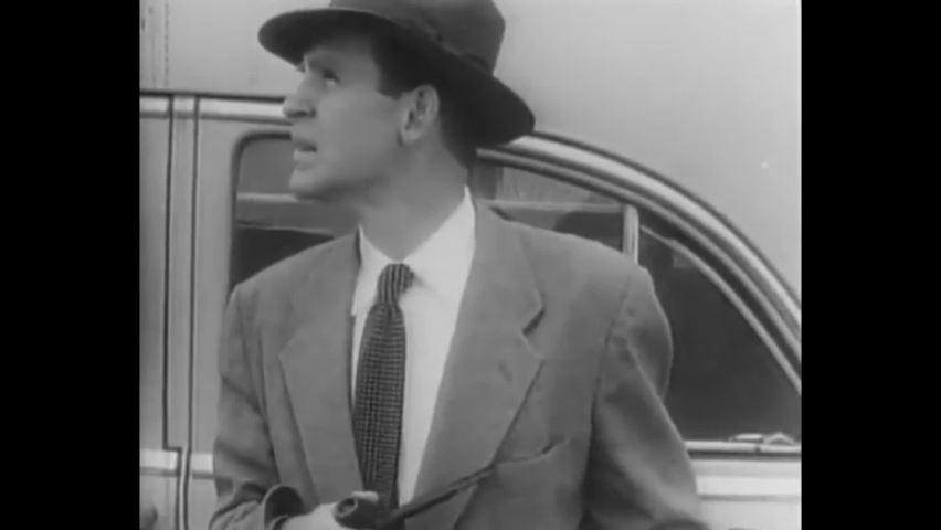 CIRCA 1955 - In this crime movie, narcotics officers set up a daytime sting operation in a parking lot in downtown Los Angeles, California. | Shutterstock HD Video #1060931821