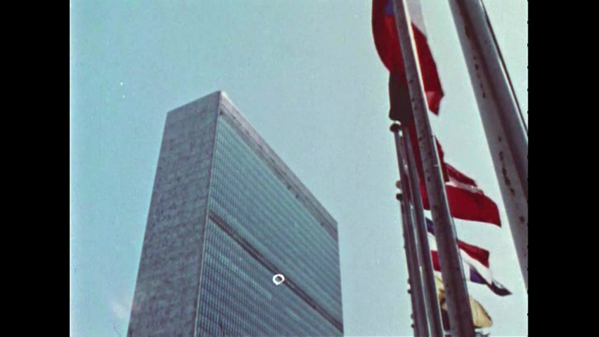 CIRCA 1967 - Bustling city life is seen outside the United Nations building in New York City, New York.