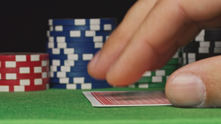 Poker player shows his pair hand two kings | Shutterstock HD Video #1060953652