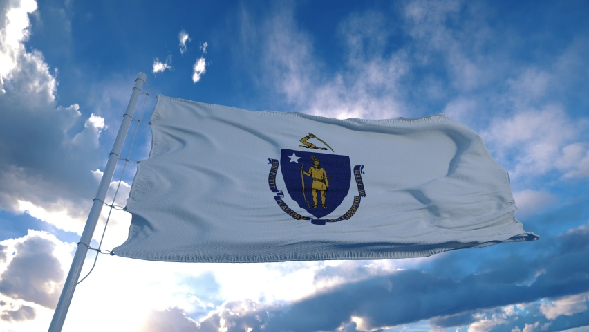Massachusetts flag on a flagpole waving in the wind in the sky. State of Massachusetts in The United States of America
