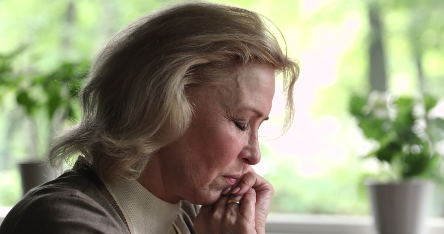Close up old woman sit indoor lost in sad thoughts grieving feels unhappy, widow mourns her husband, goes through divorce, experiences difficult life period, granny suffer from grief, disease concept Royalty-Free Stock Footage #1060968130