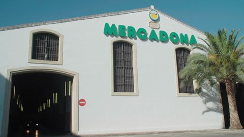 Jerez de la Frontera / Spain - 08 14 2019: A car drives out of the indoor parking garage of the popular Mercadona Supermarket in Jerez de la Frontera Spain, seen from the building exterior.