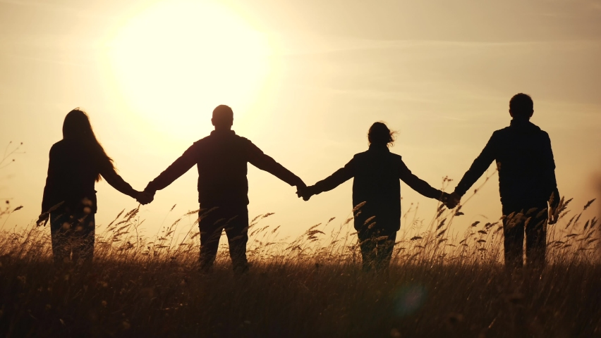 teamwork. team community hold hands together silhouette at sunset unity. group of business people hands. teamwork a workers carry out one mission go the goal. team in the company working partnership Royalty-Free Stock Footage #1060972459